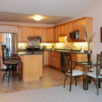 Strathcona Village Condos' open concept kitchen and dining area